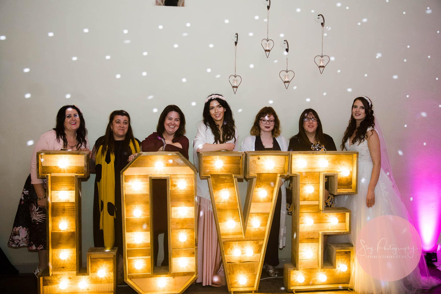 LittleWishes Large wedding letters at Dodmoor House dance floor, with guests standing behind them