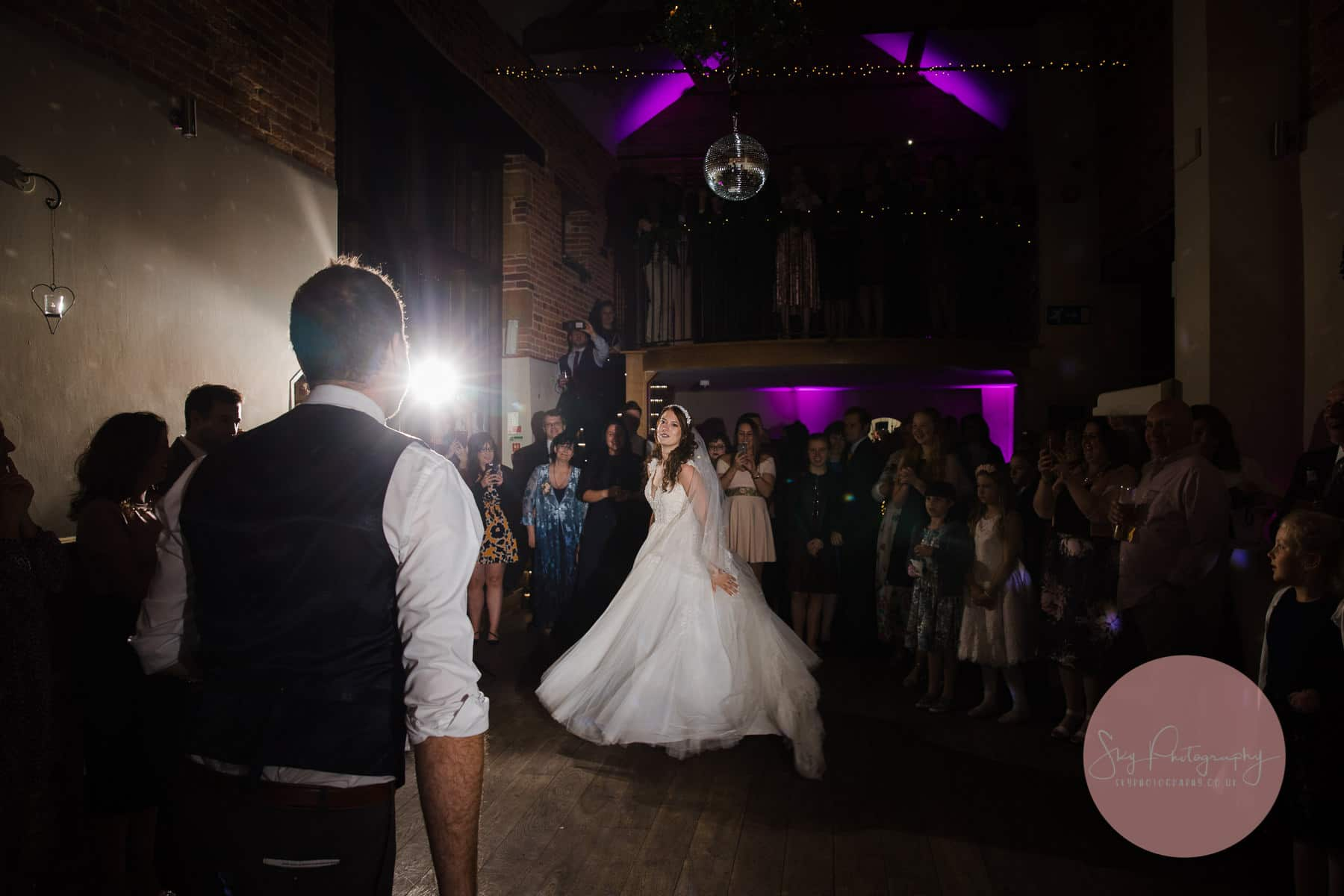Bride and Groom starting at each other across the dance floor