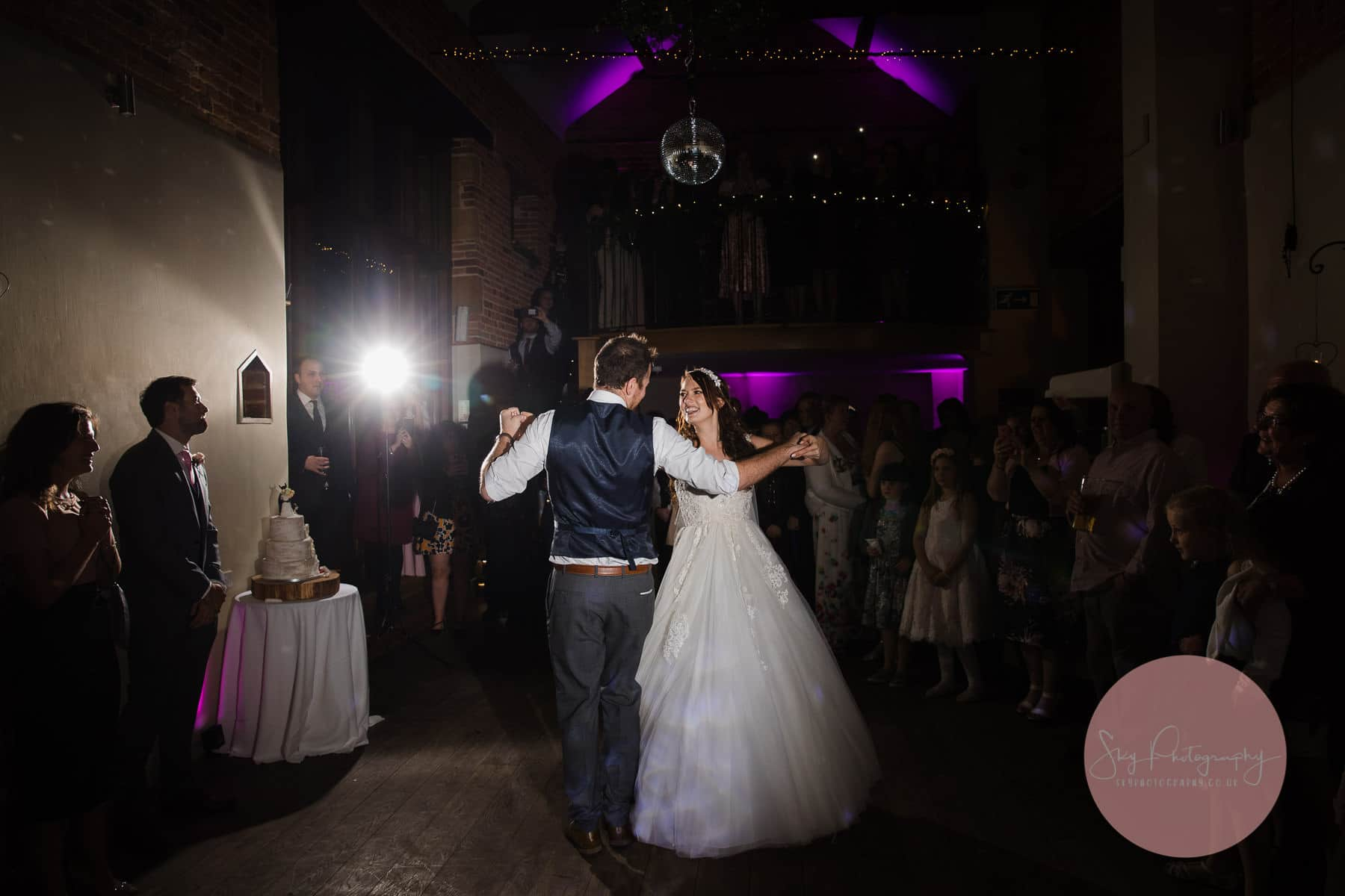 guests surrounding the couple as they perform their first dance routine at Dodmoor House