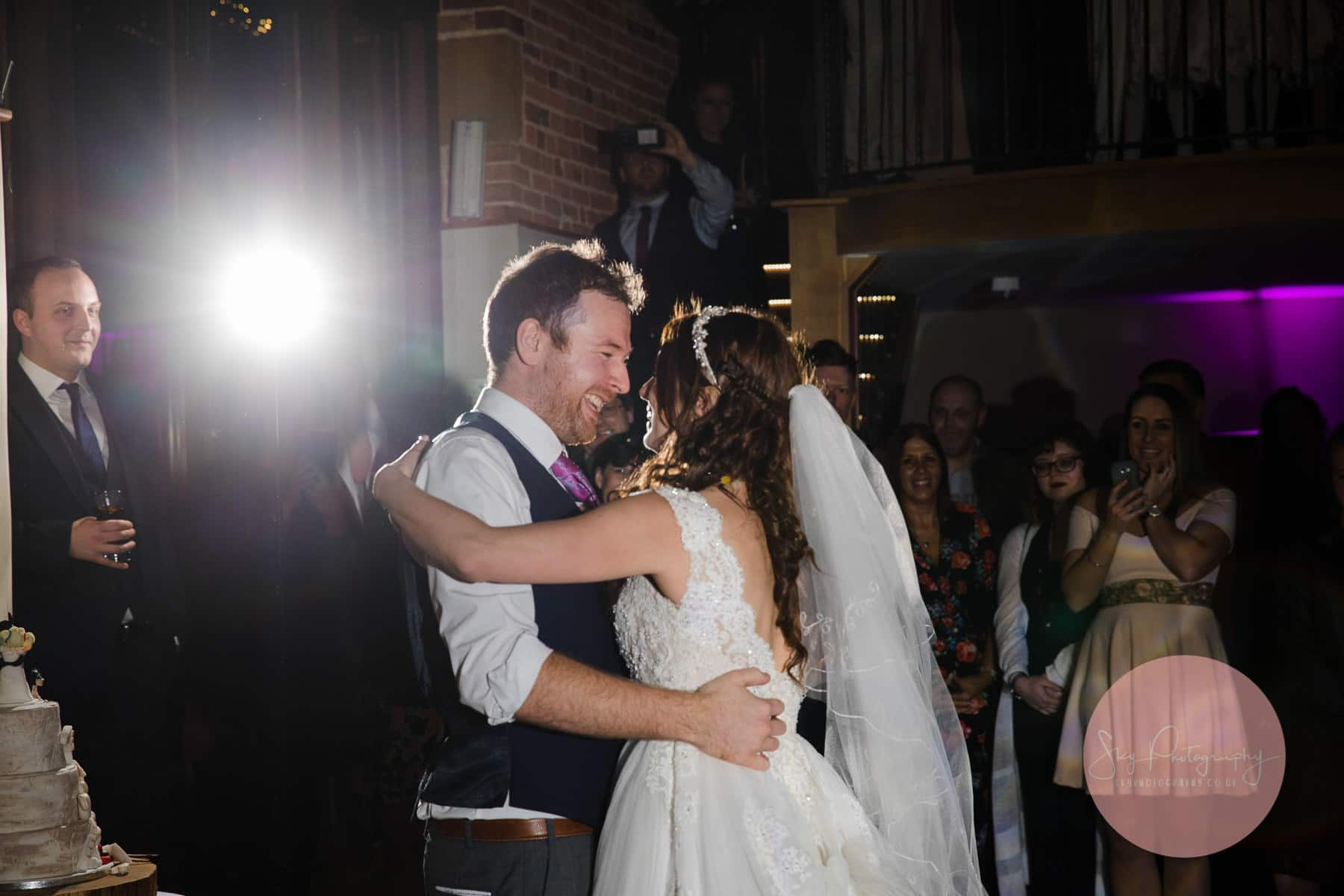 couple looking into each others eyes lovingly whilst performing a wedding first dance