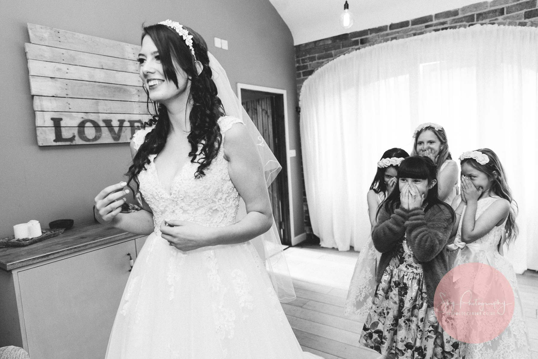 flower girls looking emotional as the bride gets ready