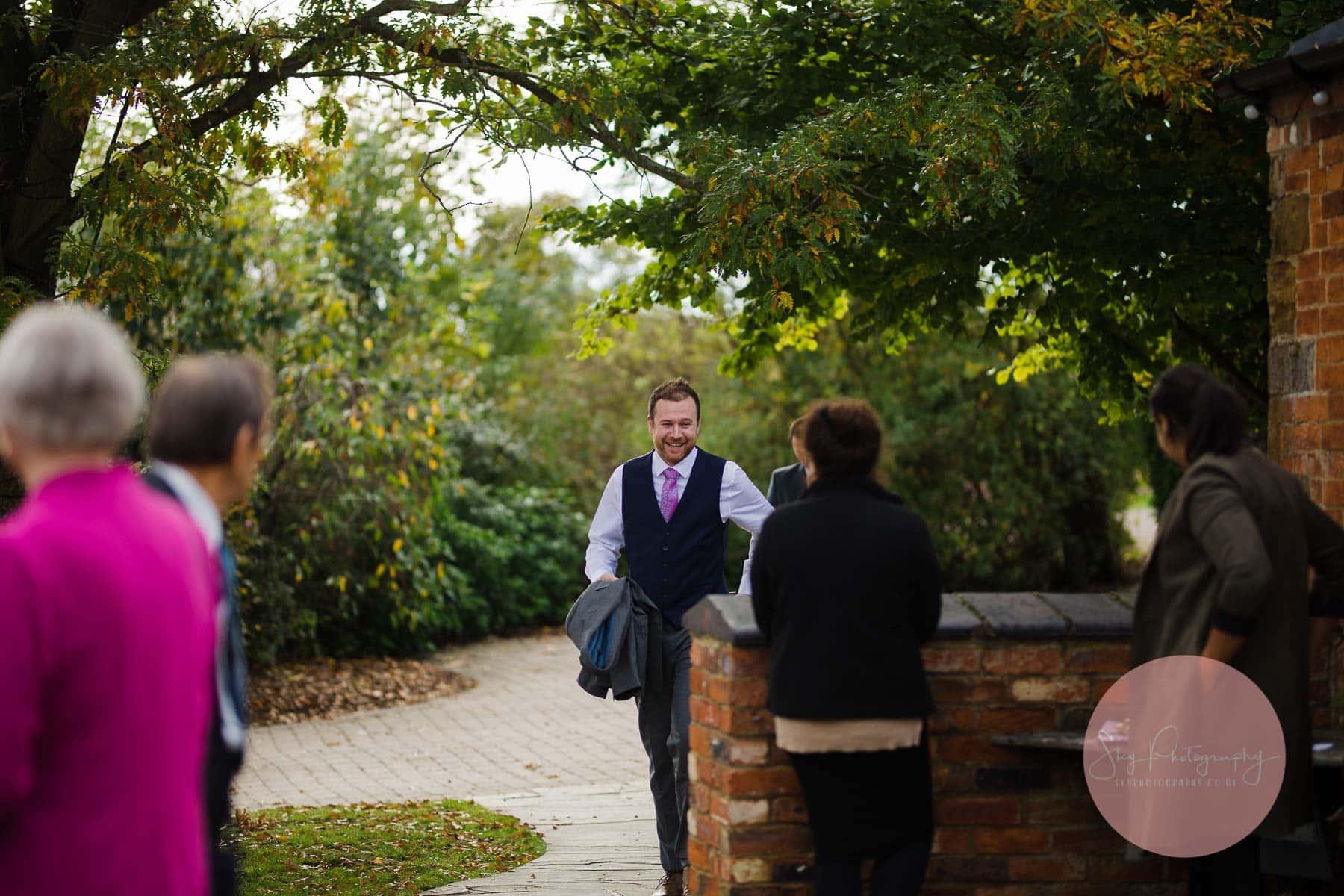 Groom arrives at the wedding venue