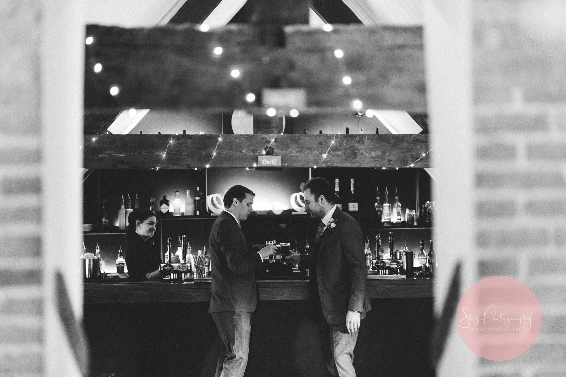 groom and best man enjoy one last drink together