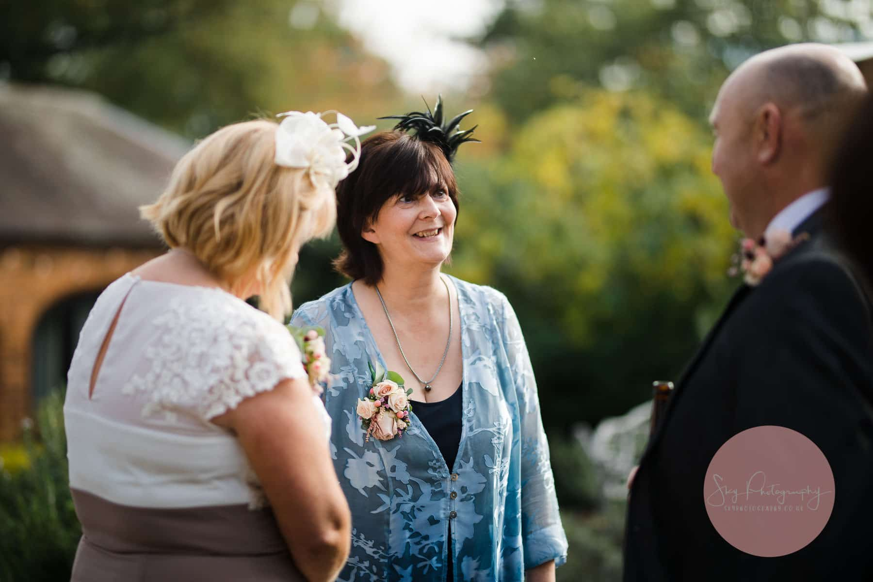 brides mother smiling and meeting guests