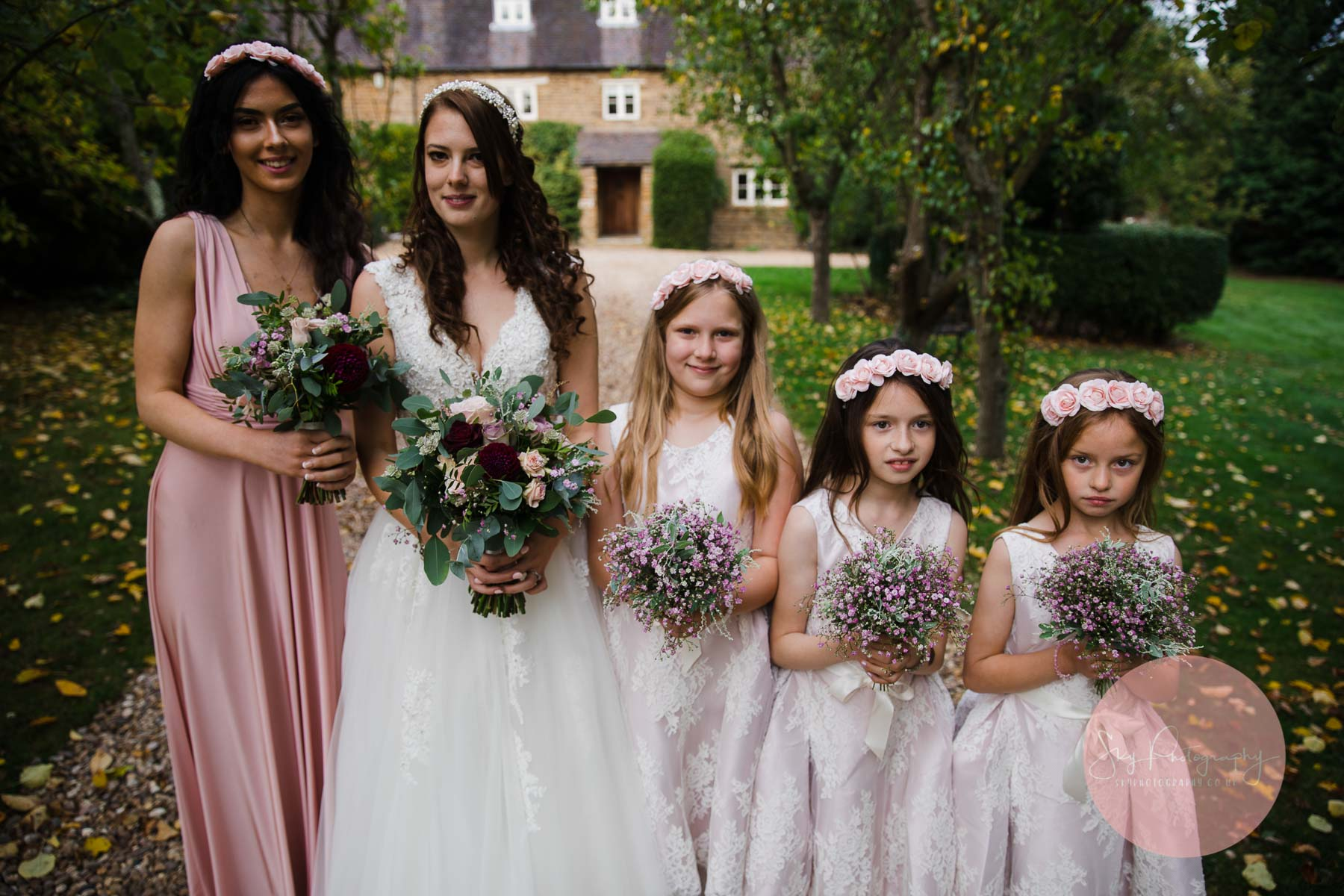 wedding party girls in a line out side wedding venue