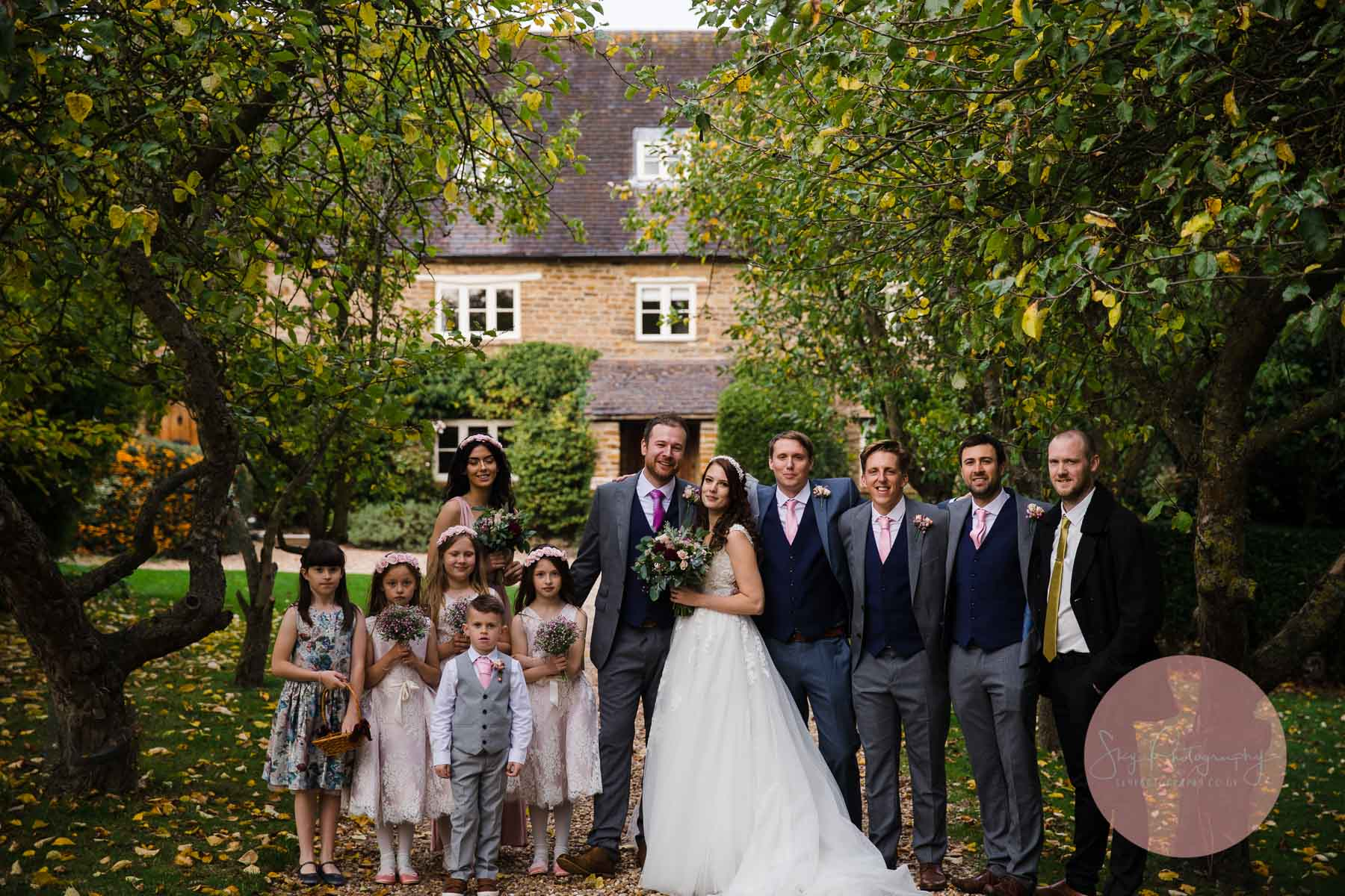 beautiful wedding party photo taken outside Dodmoor House wedding venue