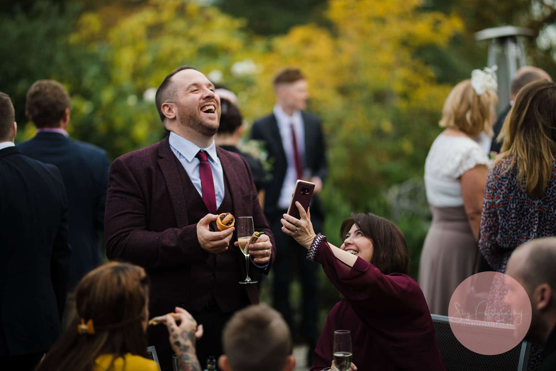 wedding guest laughing at a funny joke