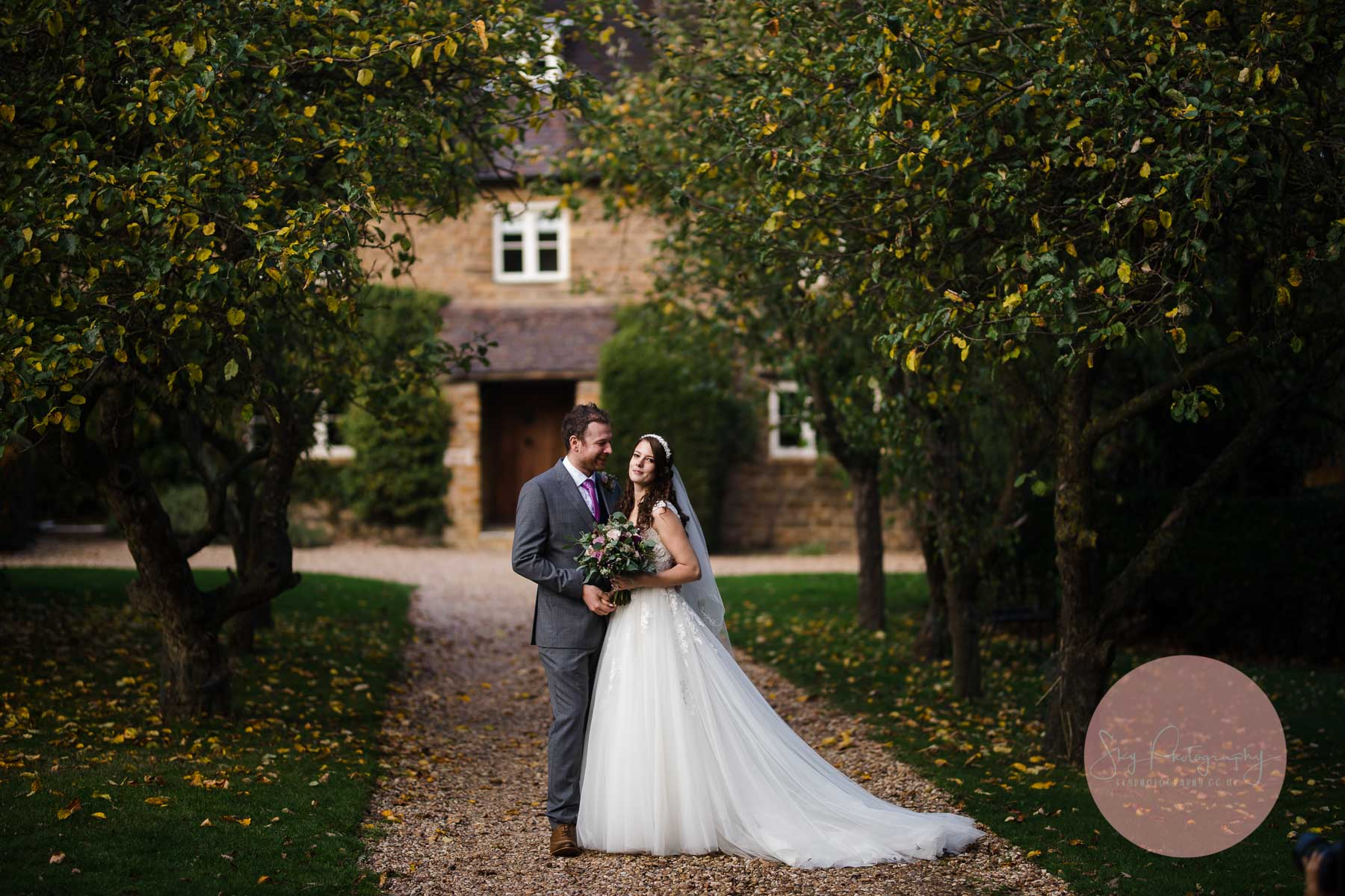 Bride and Groom standing outside the Dodmoor house wedding venue
