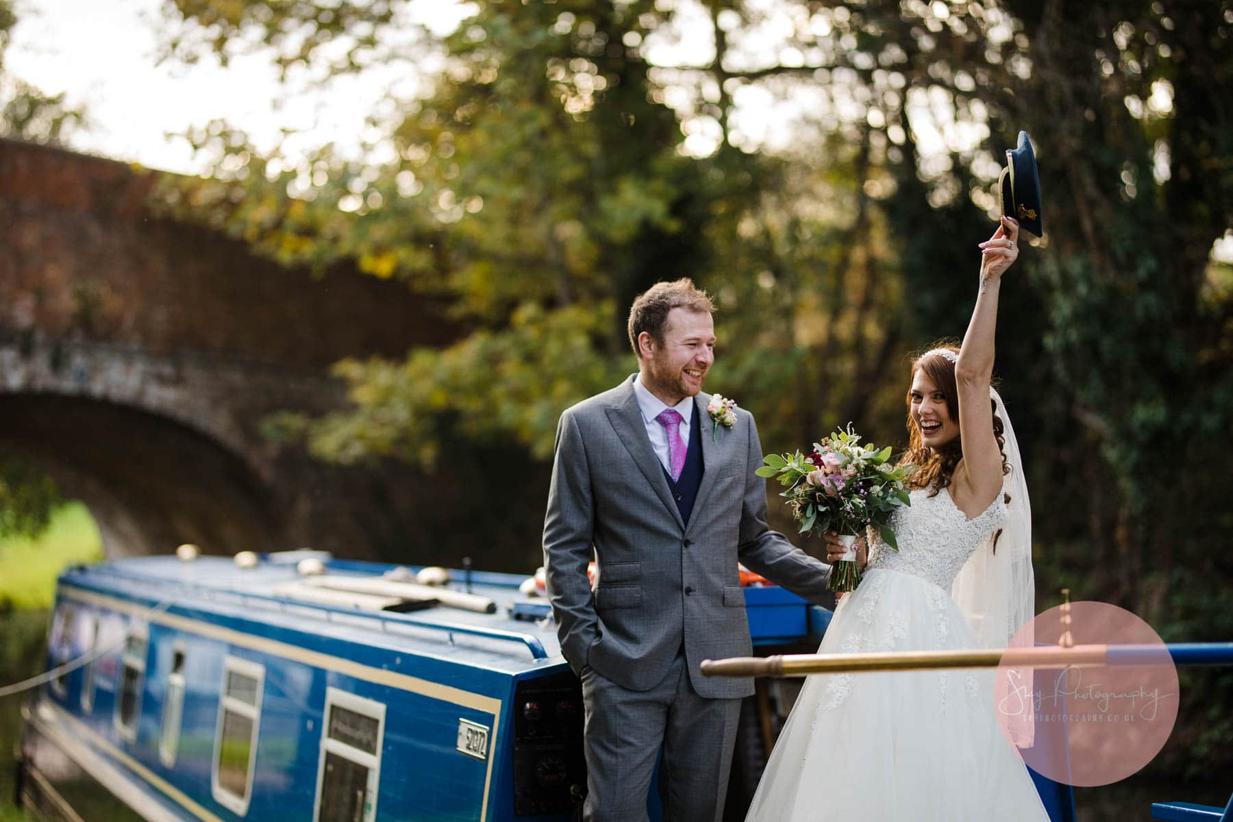 Bride on a canal boat at dodmoor house a surprise moment