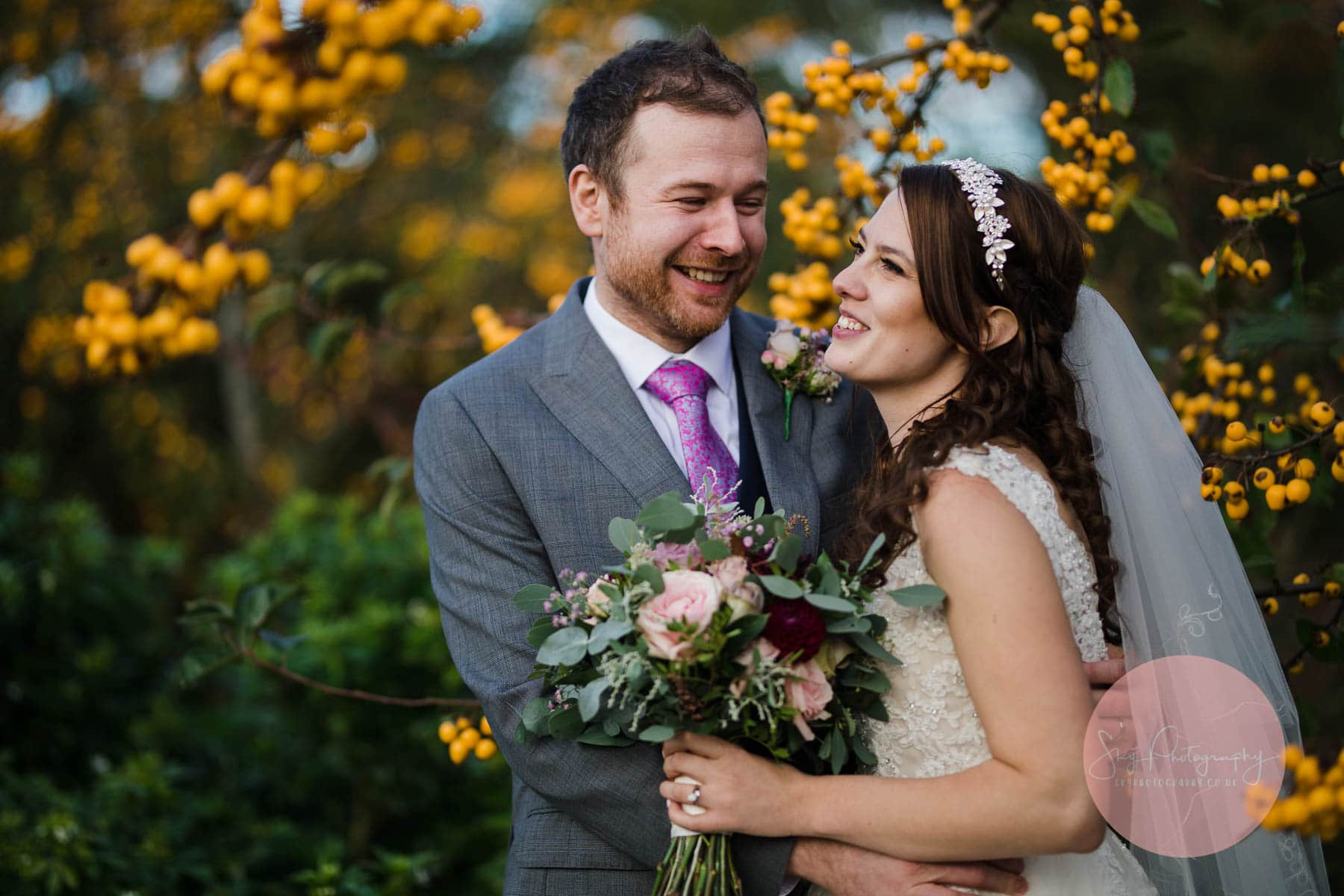 bride and groom laughing enjoying their time at dodmoor house