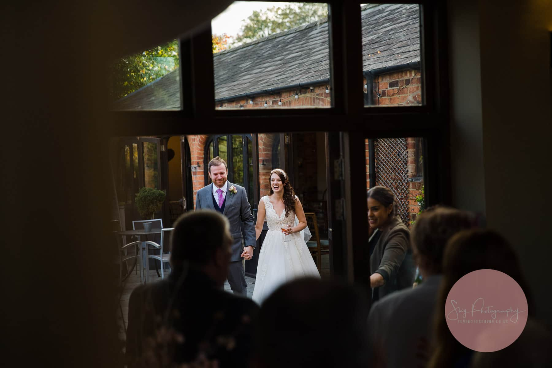 Bride and groom make their entrance at Dodmoor House Wedding