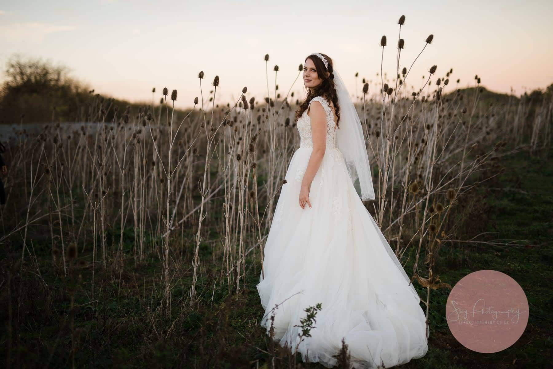 Beautiful Bride looking amazing next to some thistles