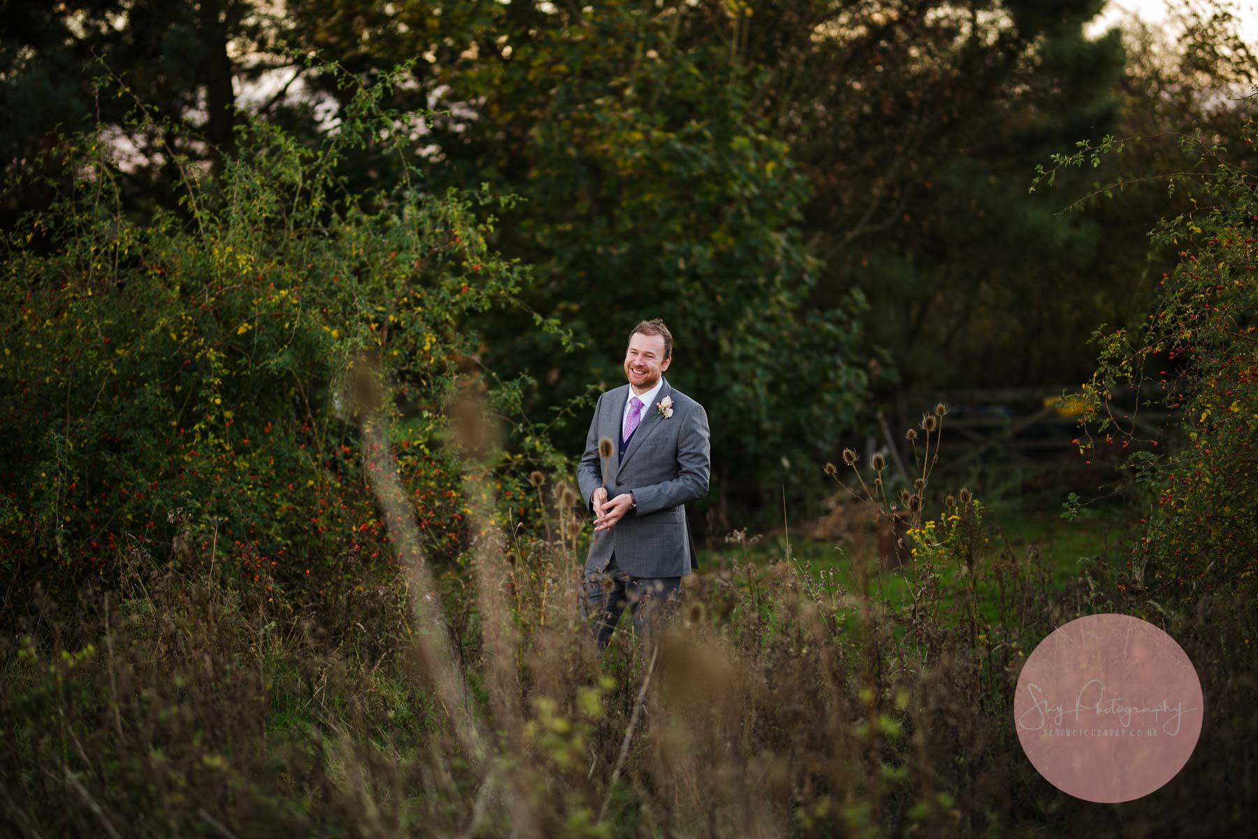 Groom looking adoringly on at his new bride