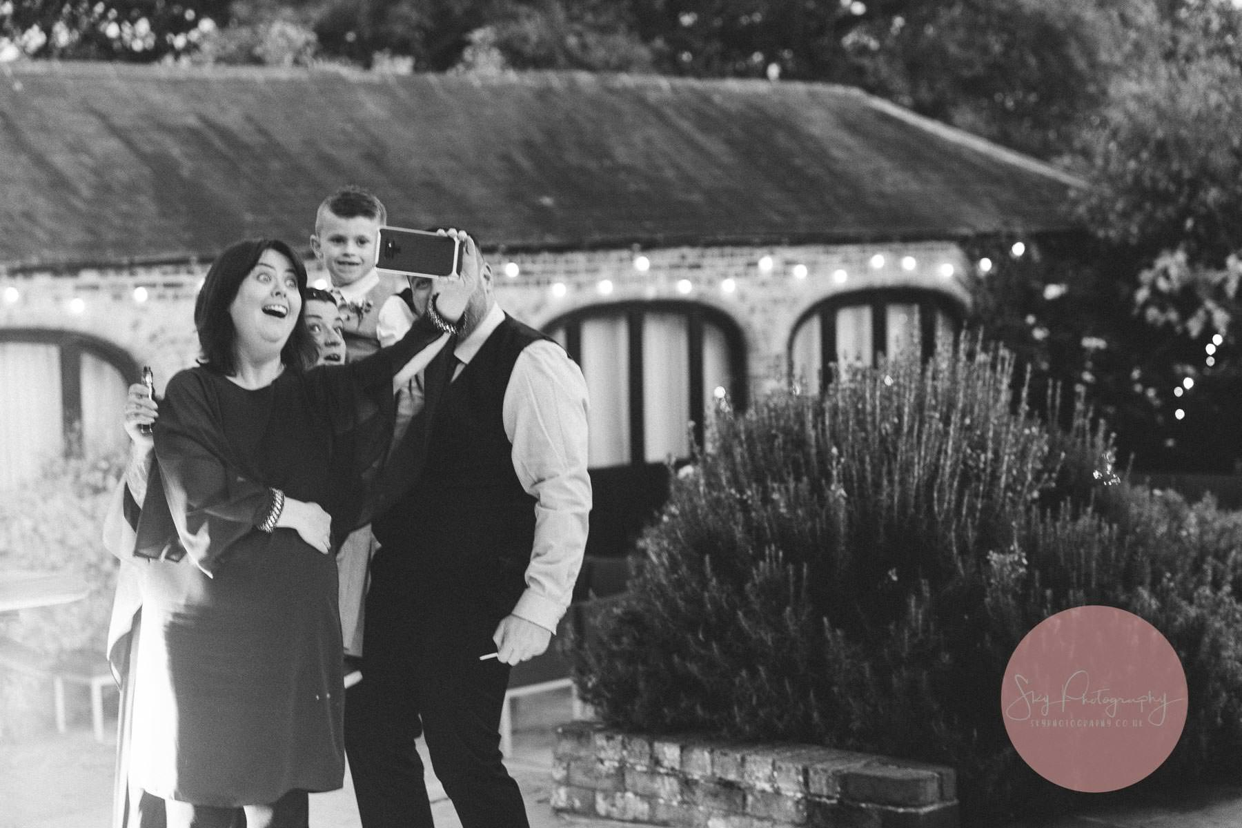 Wedding guests selfie fun
