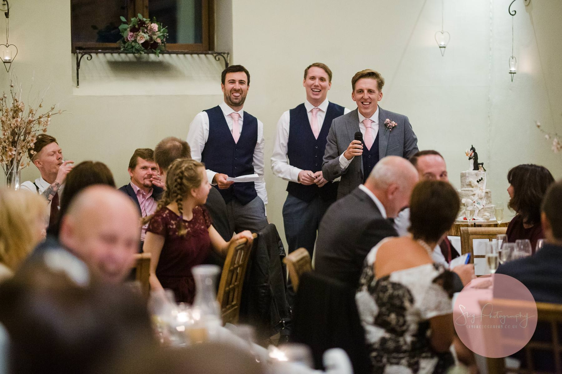 The best men performing their speech before the wedding guests at Dodmoor House