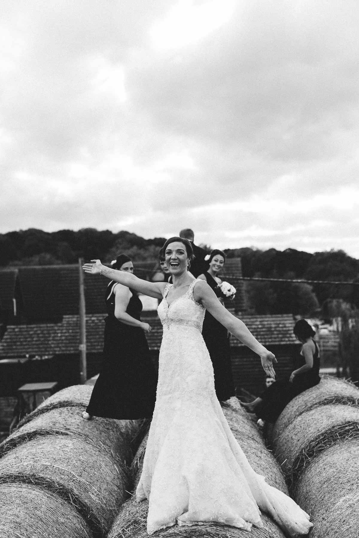 Wood Farm wedding photography of the bridal party on top of hay bales