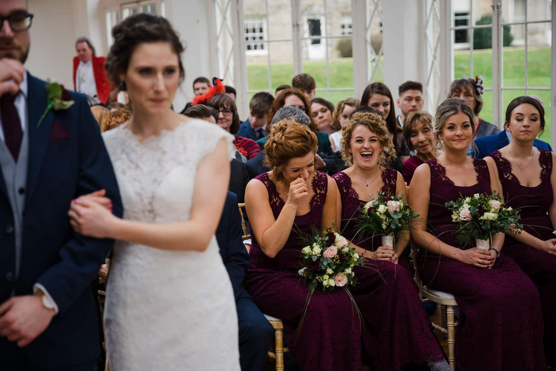 Wedding guests laughing at couple