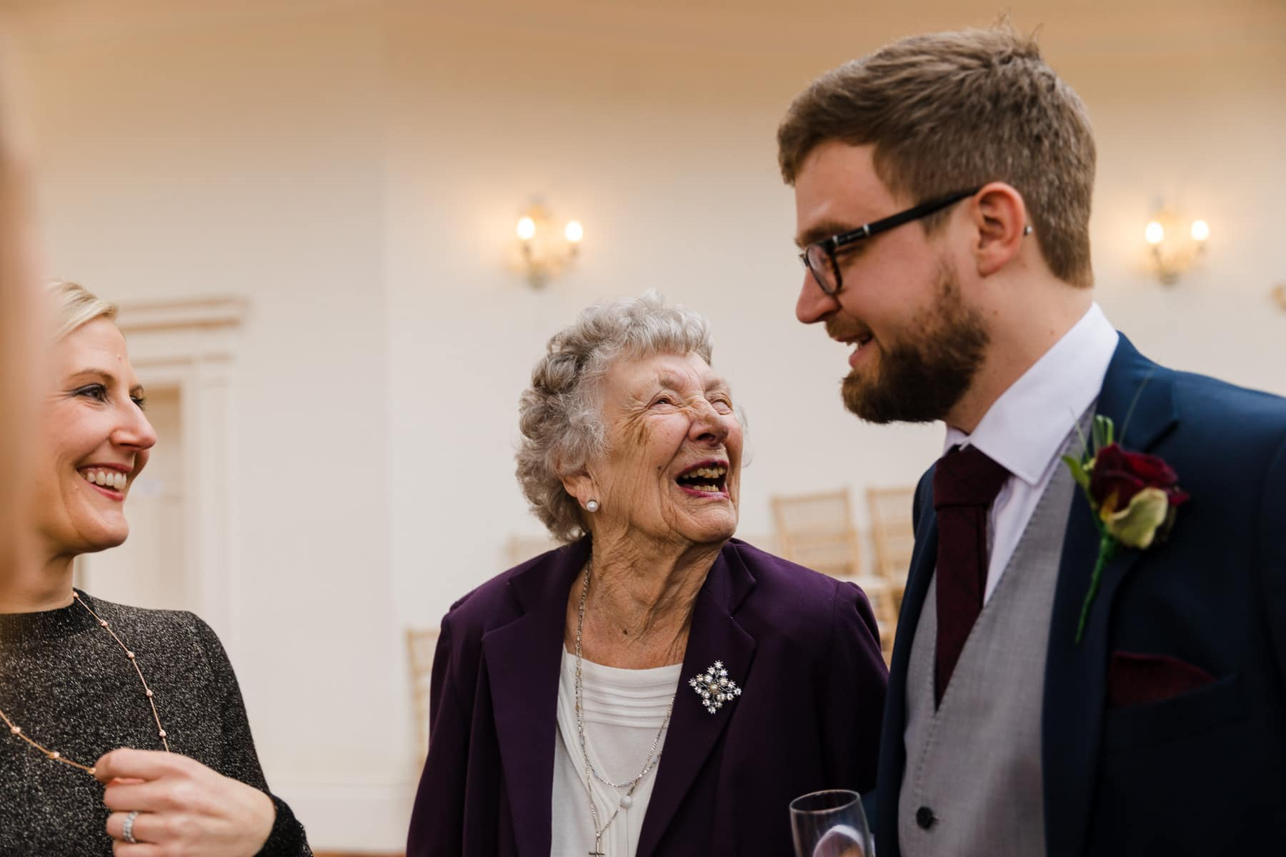 Grandma laughing at the groom
