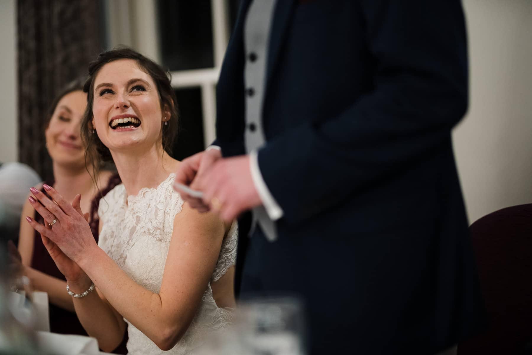 Bride reacting to grooms speech