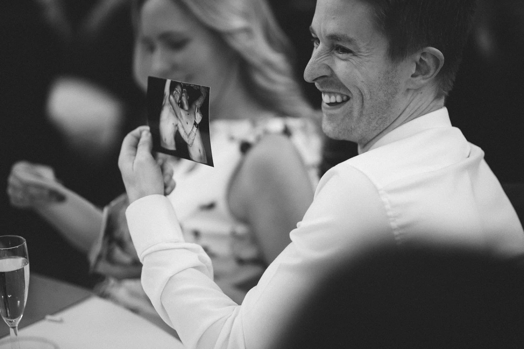 Embarrassing photos of the groom during the best man's speech
