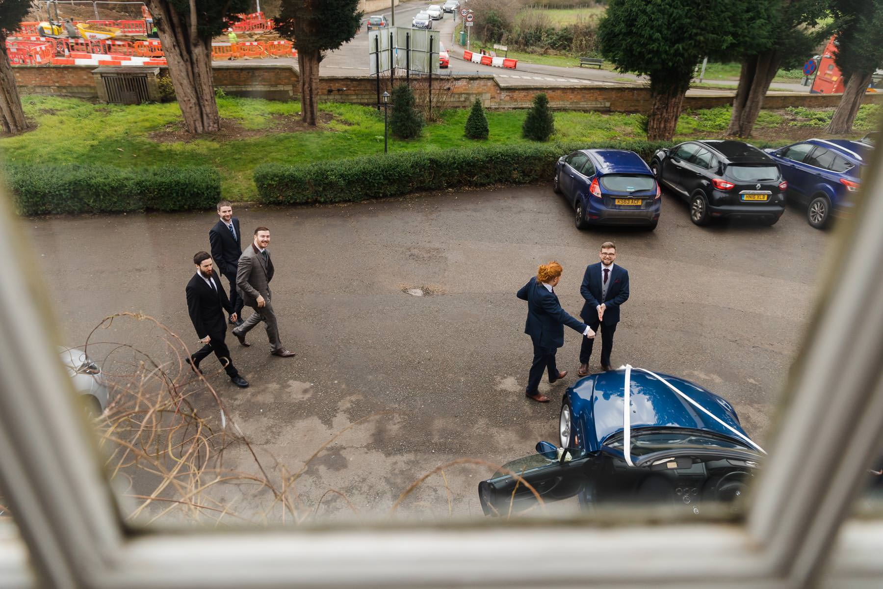 Groom arriving at barton hall with his groomsmen