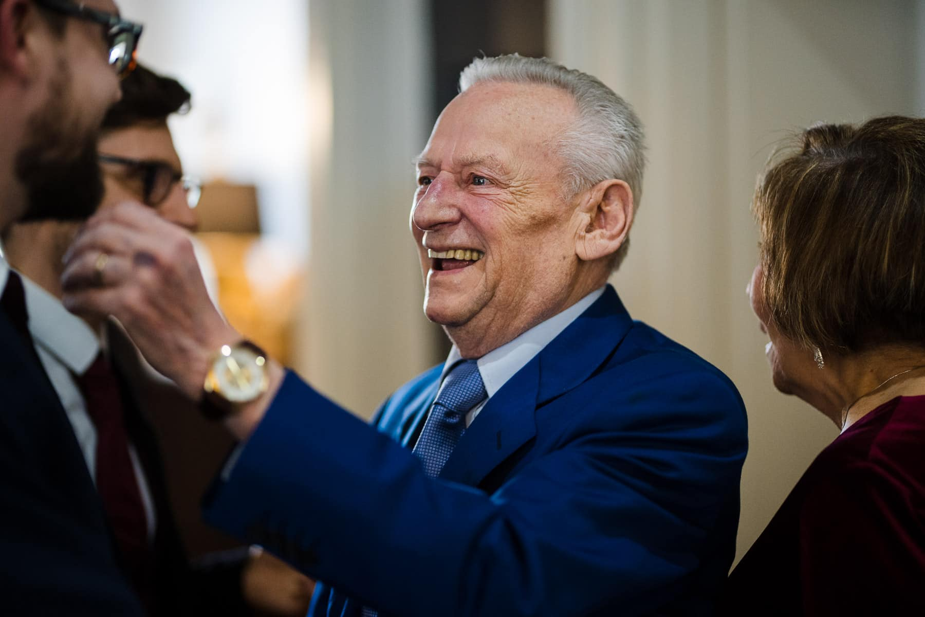 Grandad arriving and smiling at groom