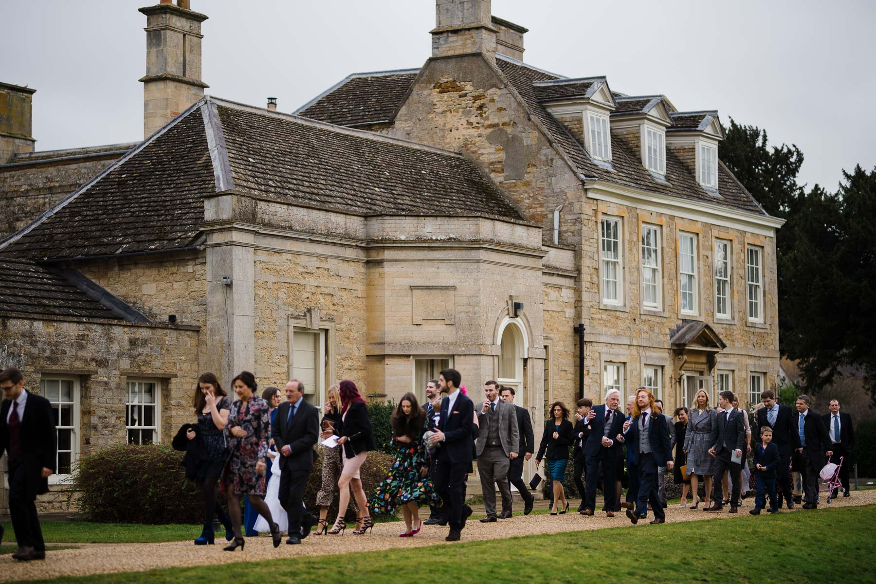 wedding guests making their way to Barton hall orangery