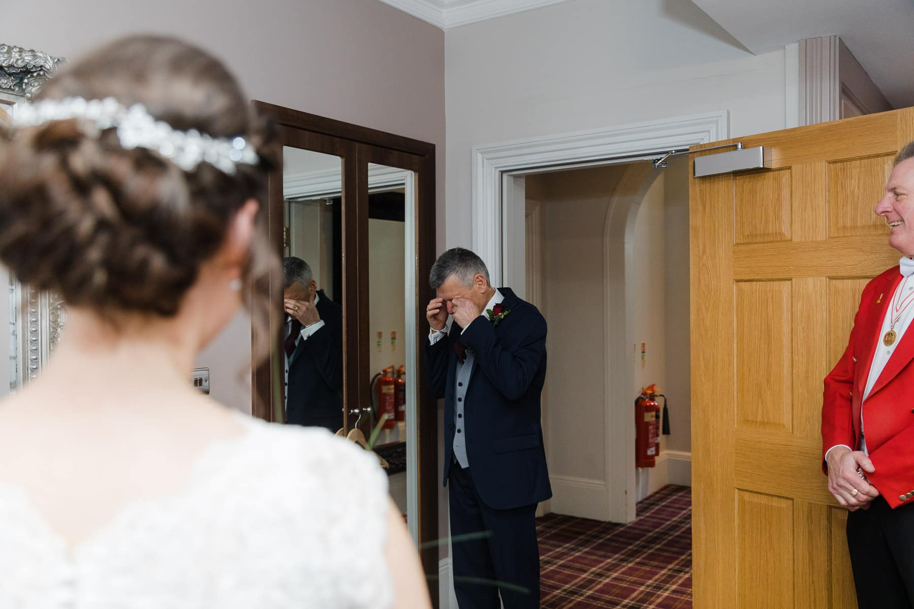 Emotional father seeing his daughter in her dress for the first time