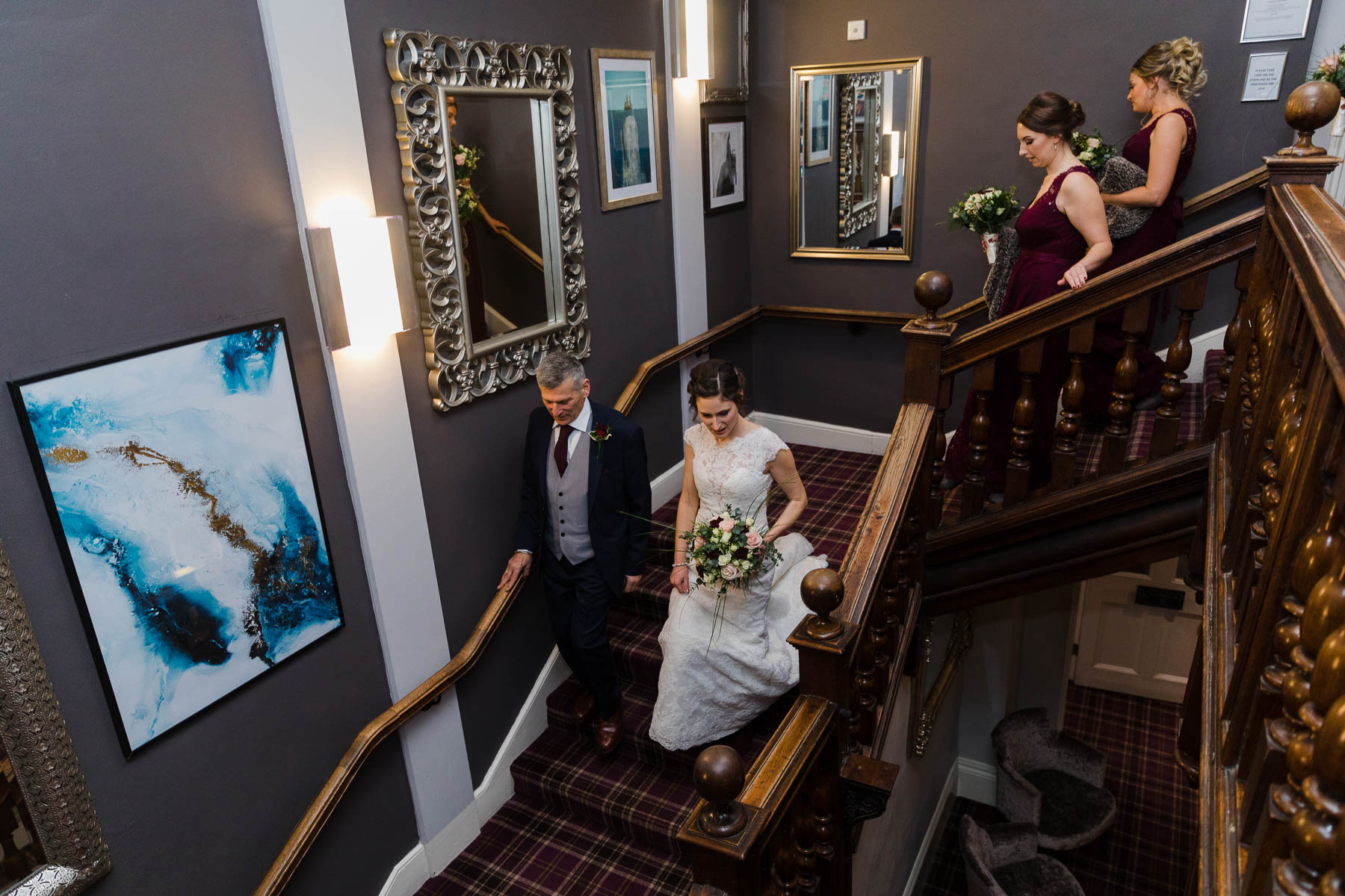 Bride and Father walking down the stairs to get married