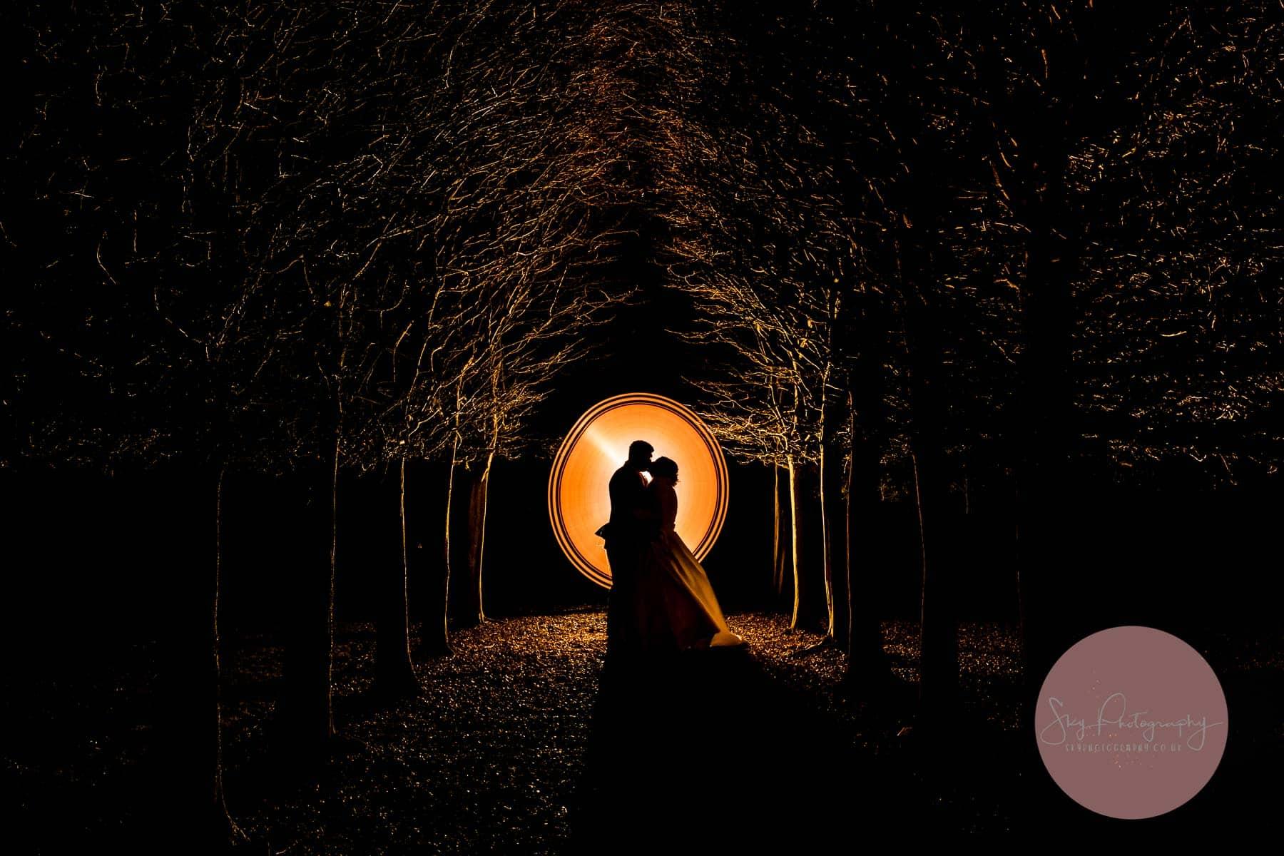 Fawsley Hall Wedding Photographer taking a stunning night magmod photo