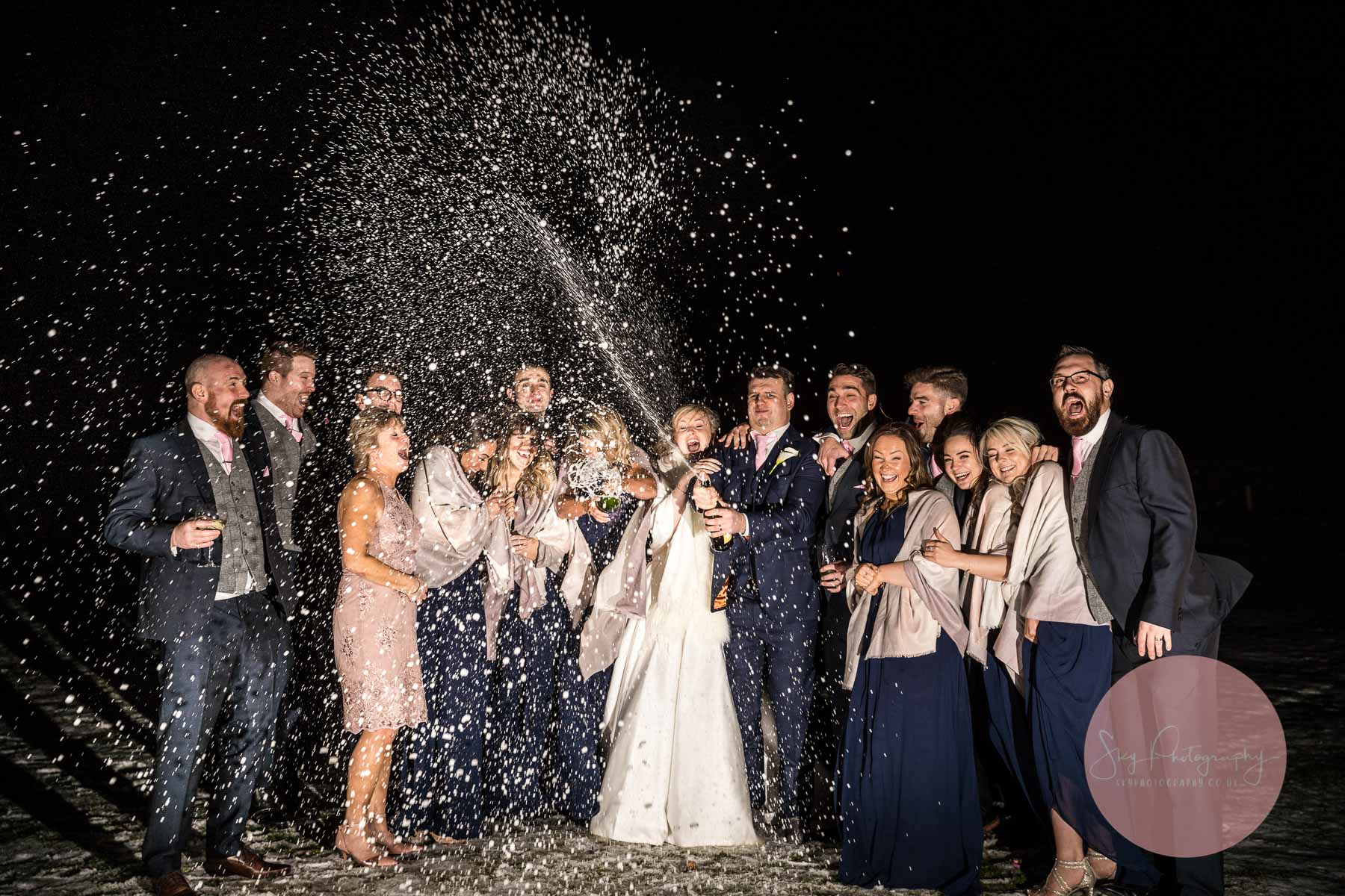 Amazing Champagen wedding photography of the wedding party laughing and smiling