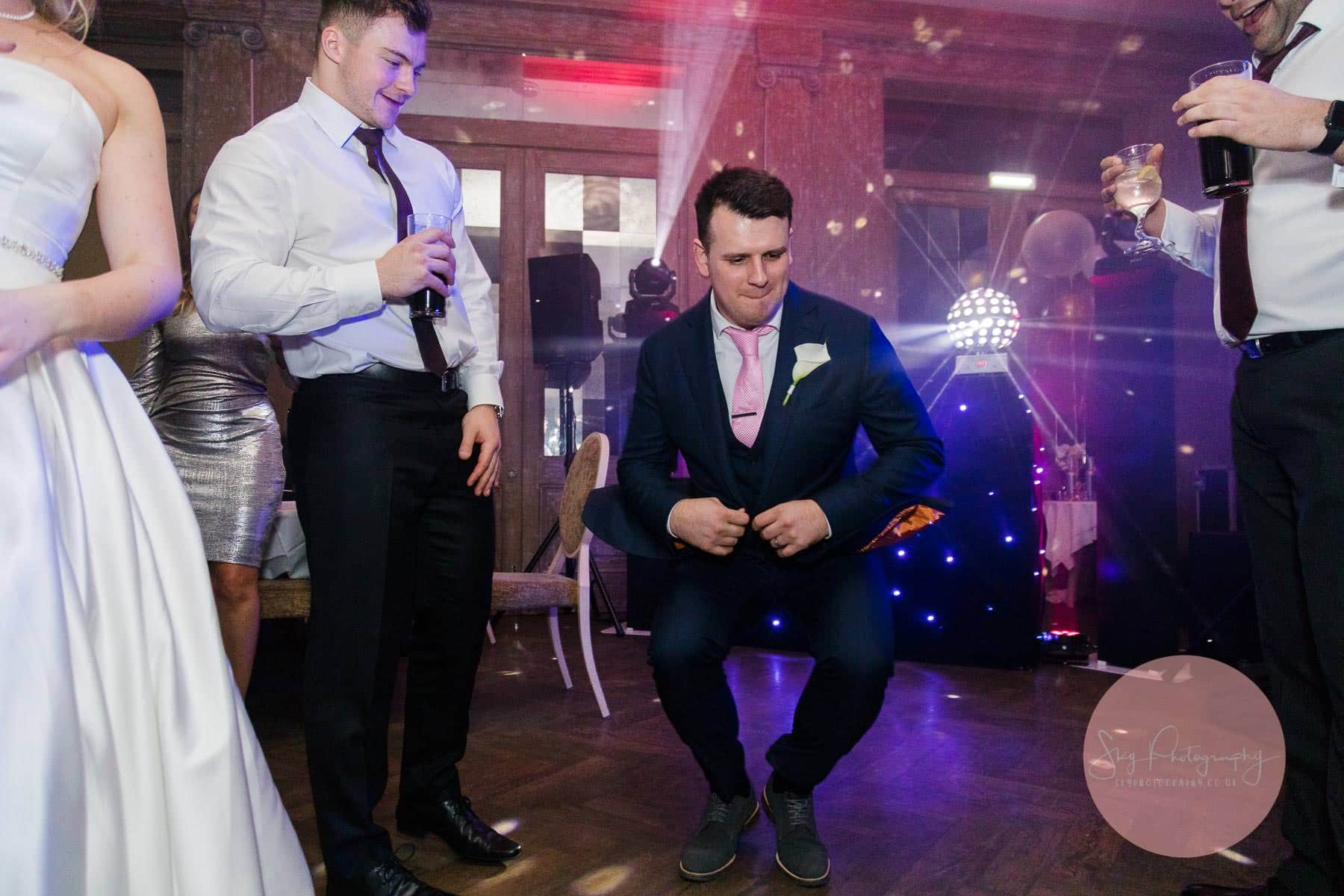 Groom doing a russian dance