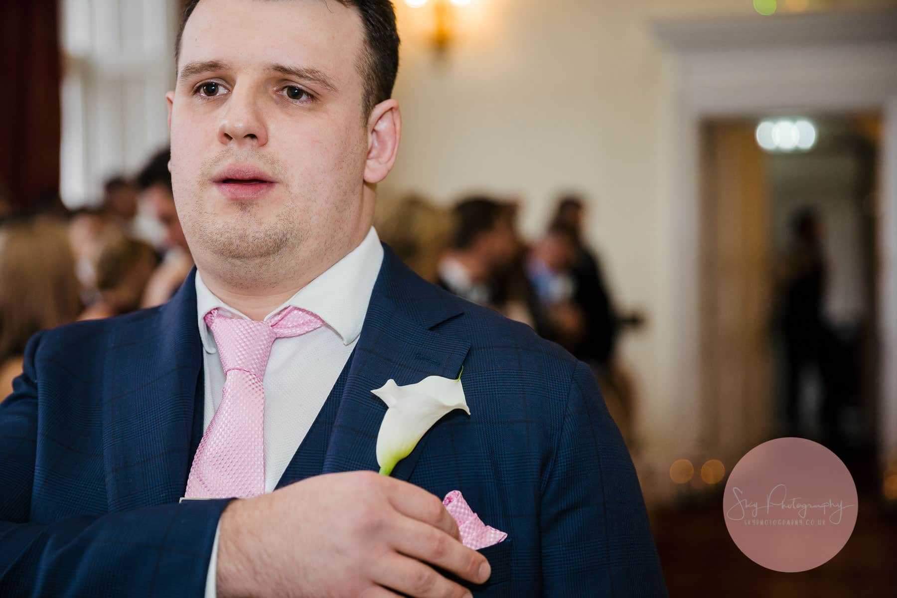 Groom emotionally crying whilst aiting for his bride to come down the aisle