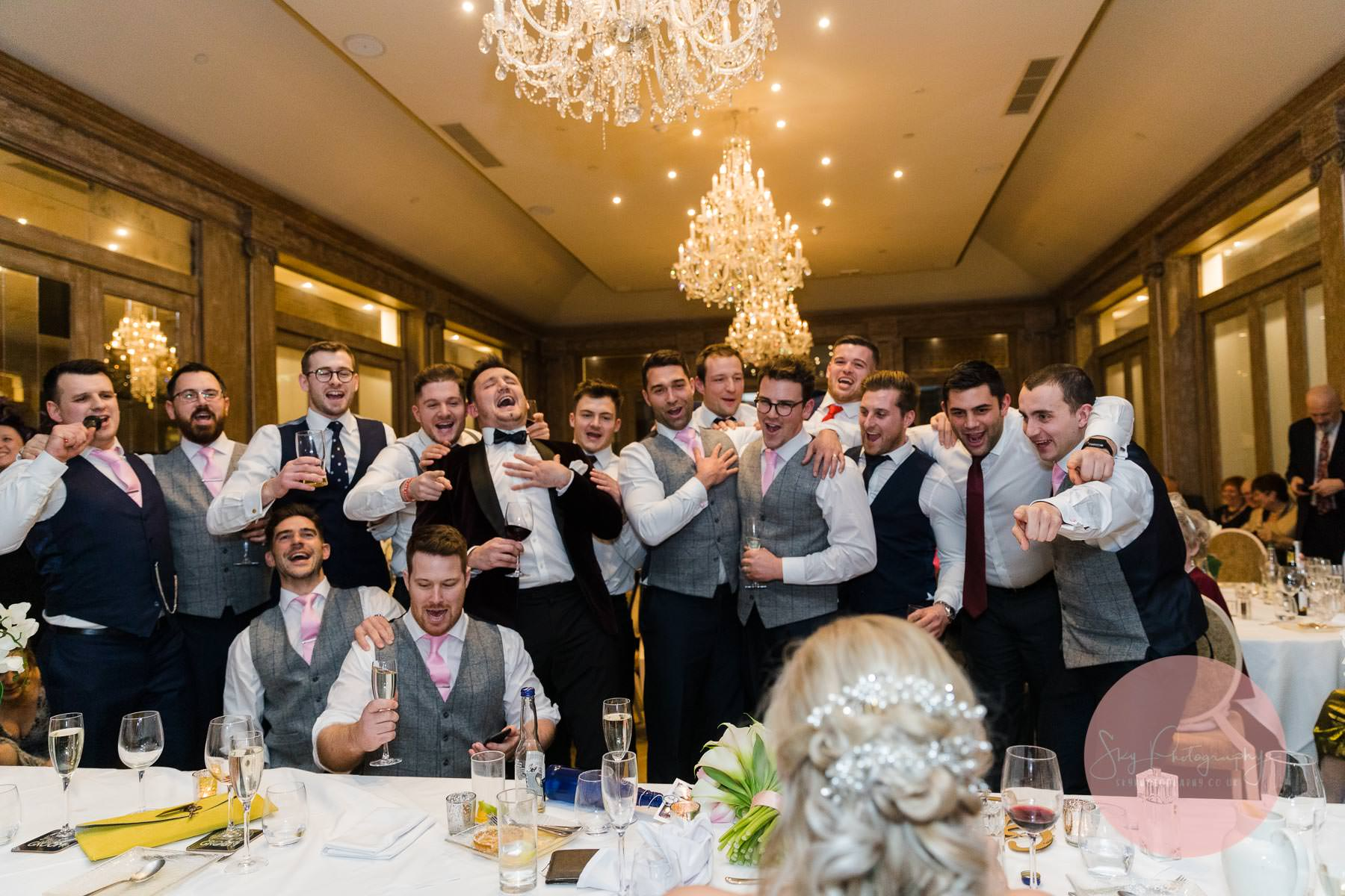 All the groomsmen singing to the bride a great wedding speech idea