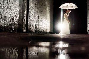 Beautiful rain and umbrella photo of the couple