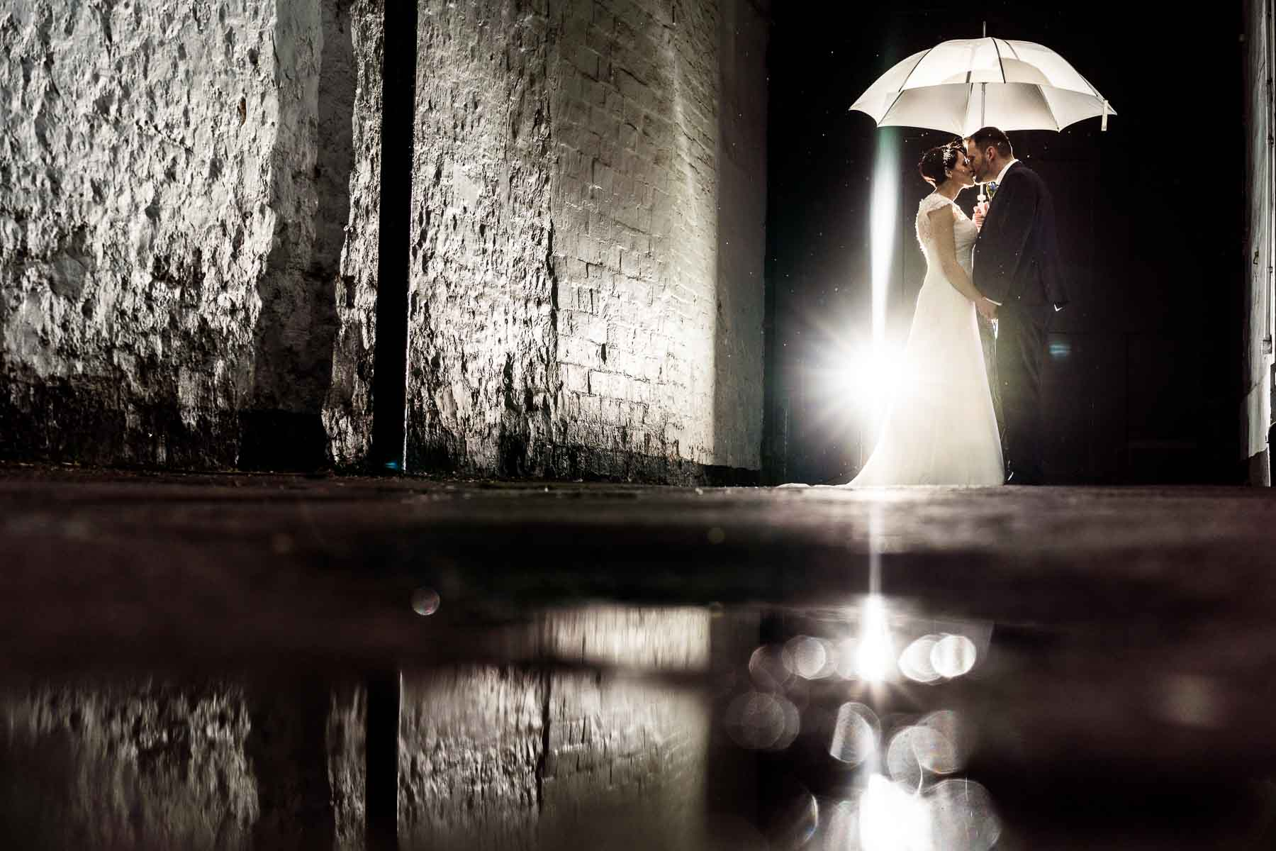 Beautiful rain and umbrella photo of the couple