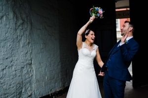 bride hitting groom on the head with flowers