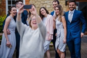 Random stranger taking a selfie with wedding guests