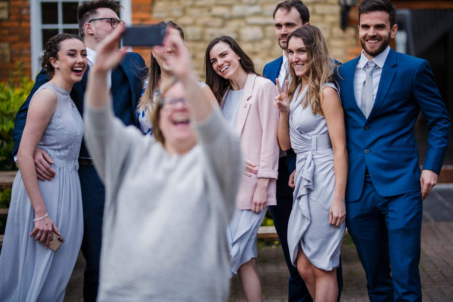 Random stranger taking a selfie with wedding guests