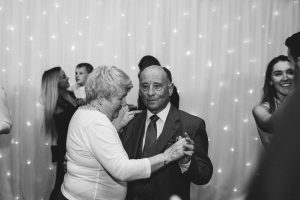 Uncle and Aunt gracefully dancing after first dance