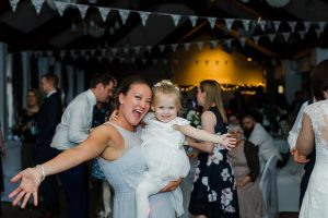 Bridesmaid dancing with flower girl on the dance floor