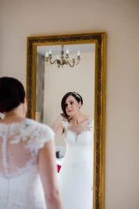 Bride admiring herself in the mirror buckinghamshire wedding photographer