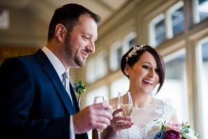 Bride and groom celebrating after being married at a ceremony at the Cock Hotel Buckinghamshire