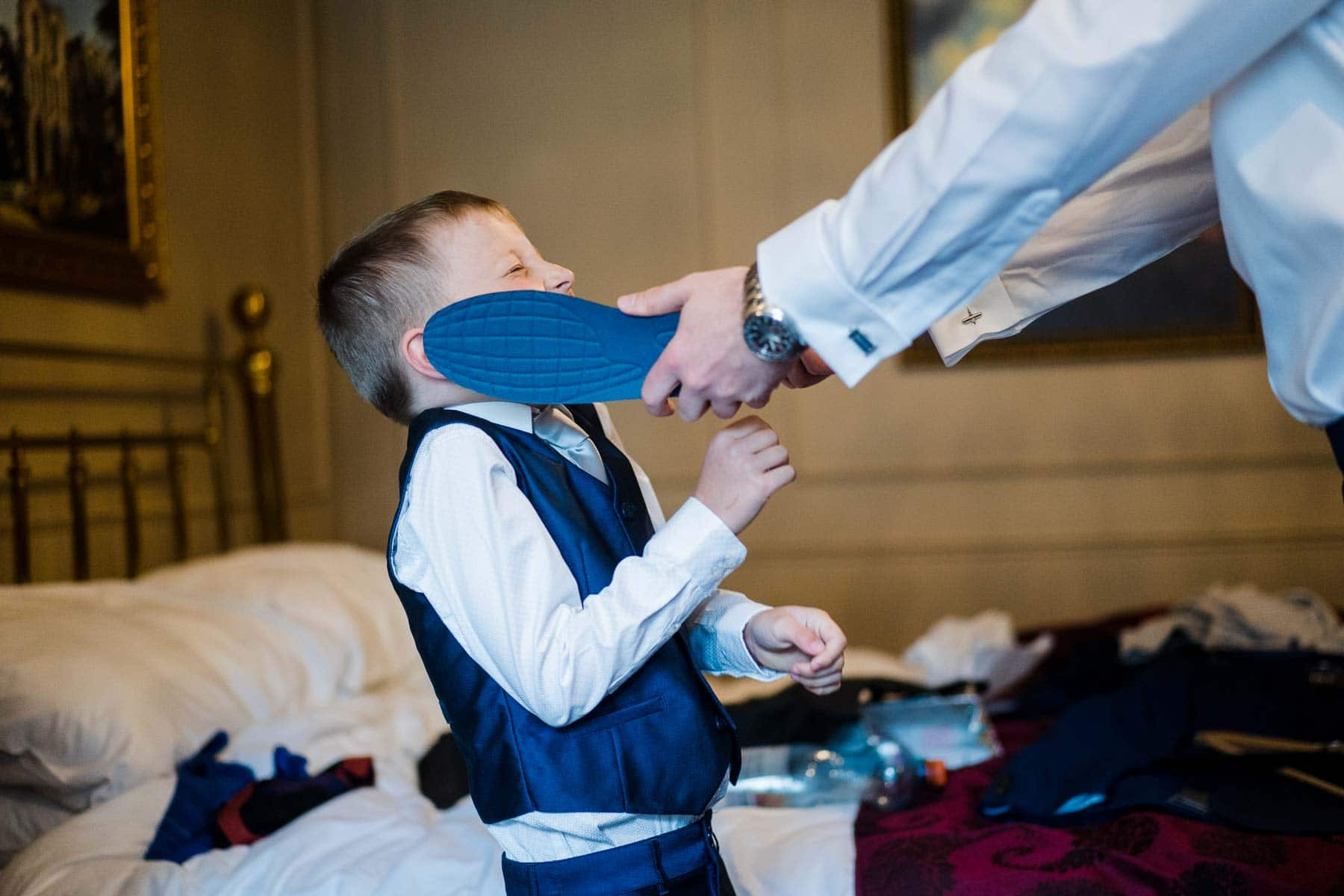Father and son playing in groom preparations