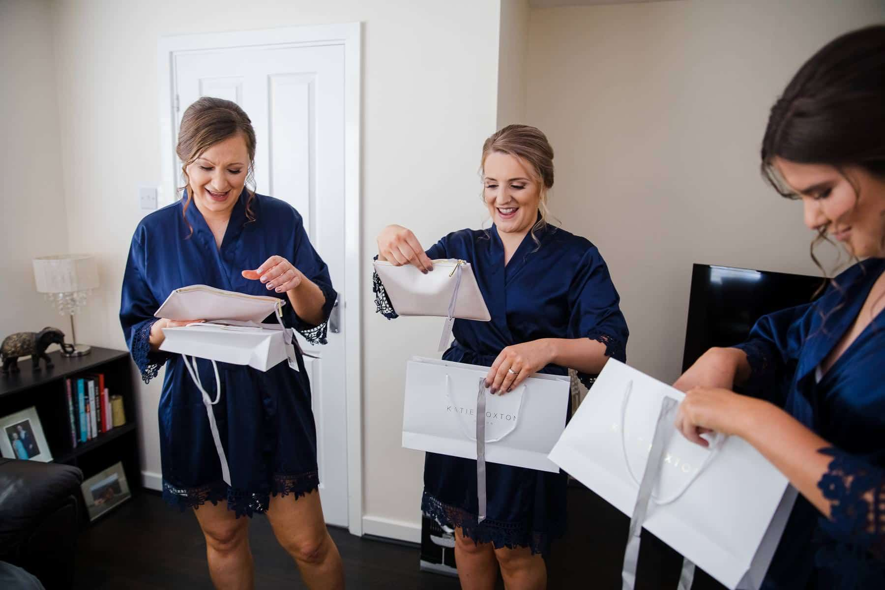 Bride giving bridesmaids their gifts