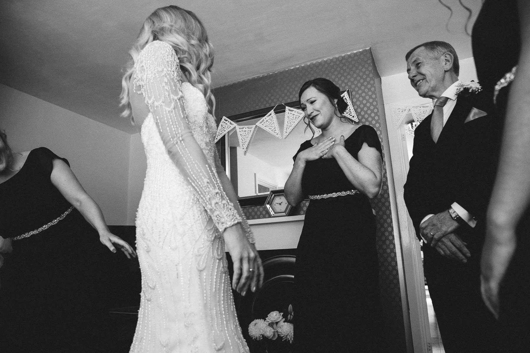 EMotional bridesmaids seeing the bride and her dress for the first time
