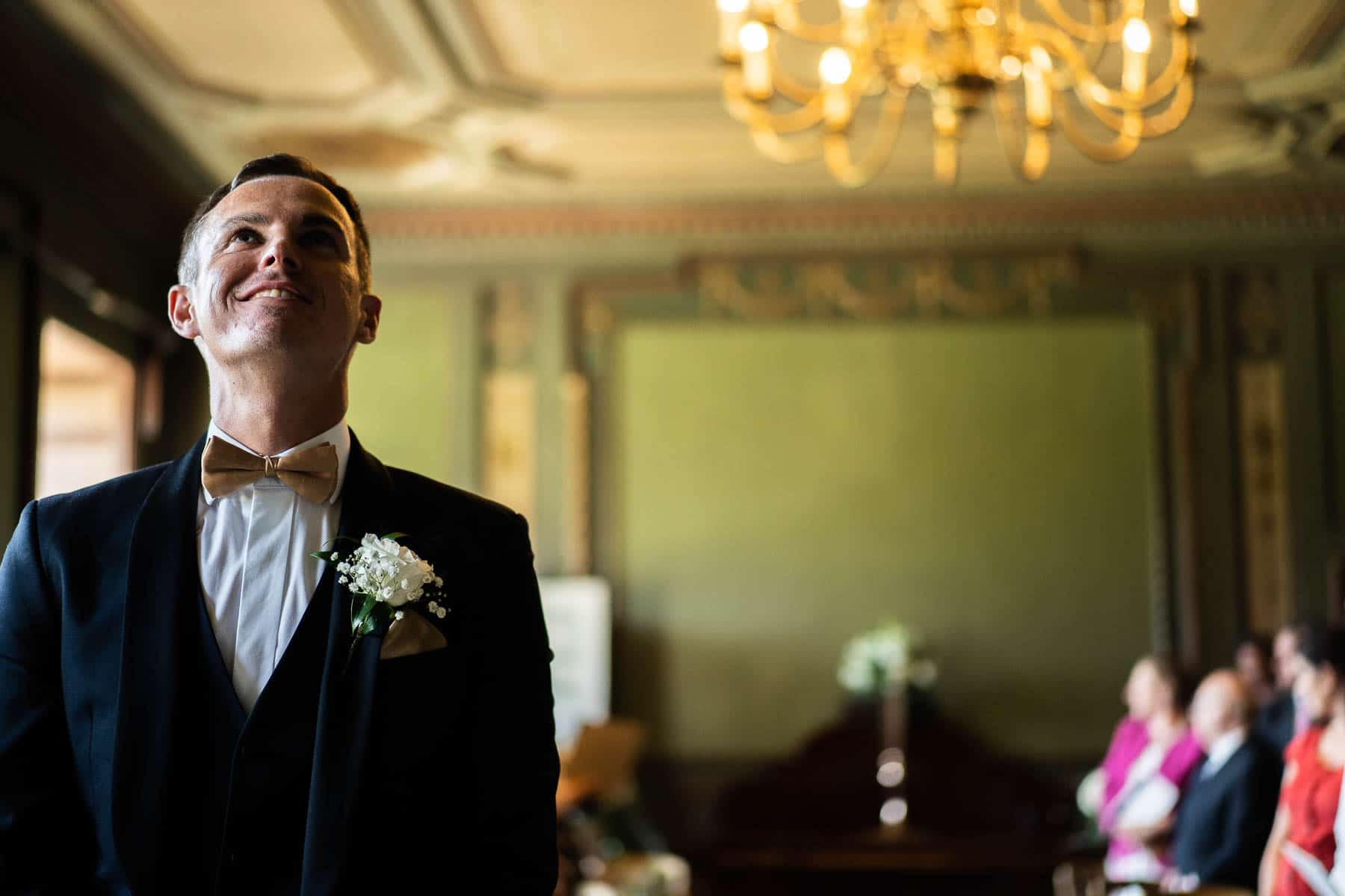 Groom nervously waiting for his bride at the alter, a beautiful photo taken in the bouverie room at delapre abbey