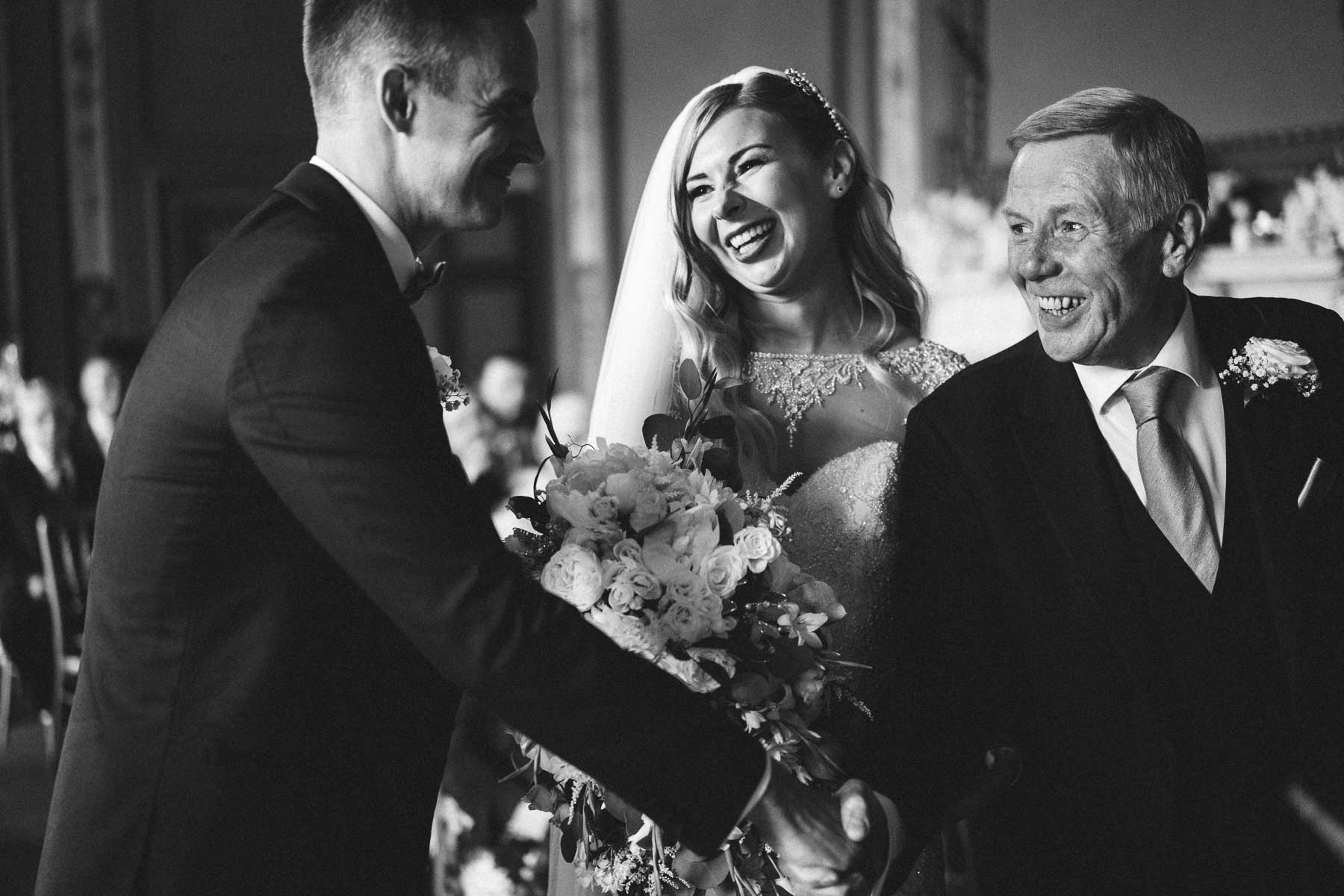 Father of the bride beaming with pride as he says goodbye to her
