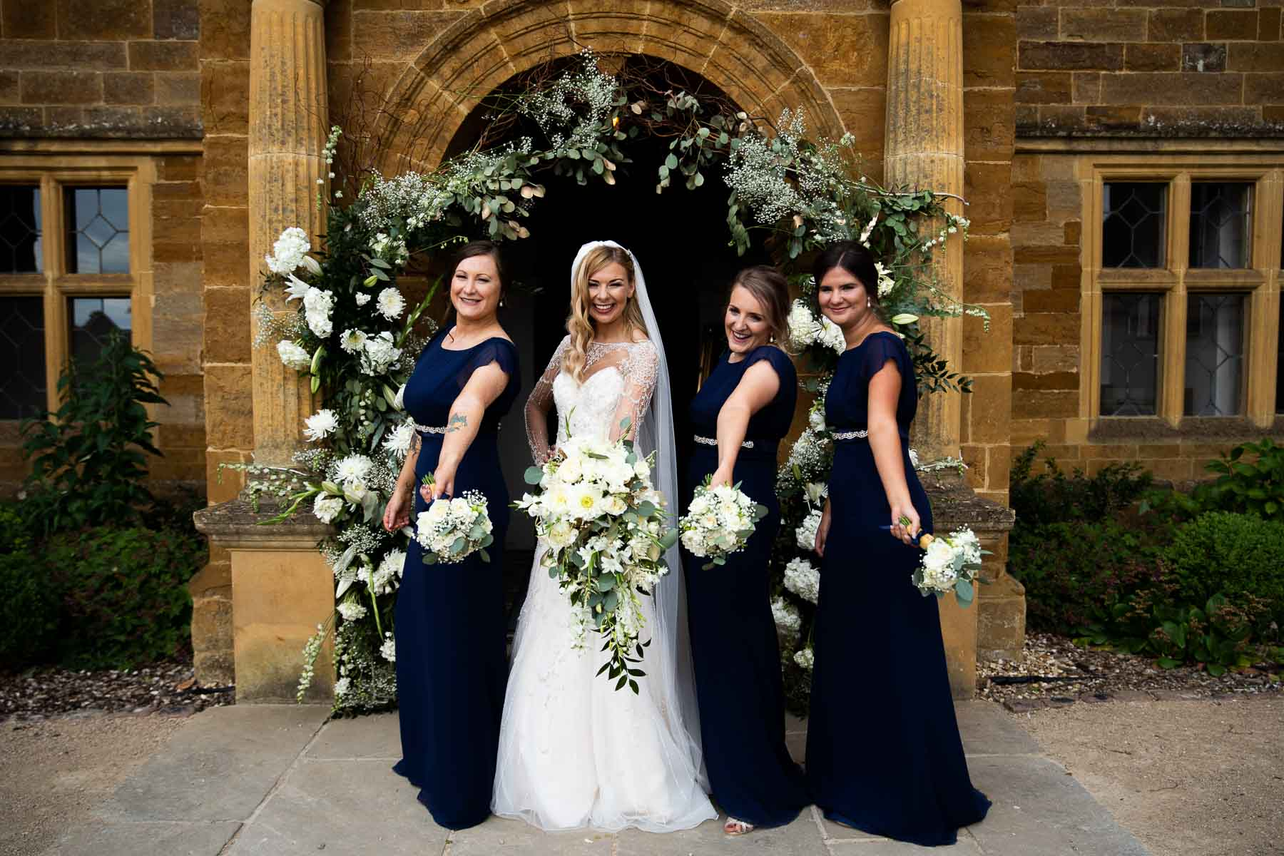 Bridesmaids standing near the parking at delapre abbey