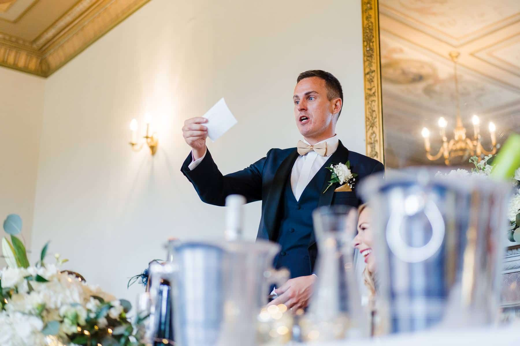 Wedding photography of the groom delivering his speech of delapre guests